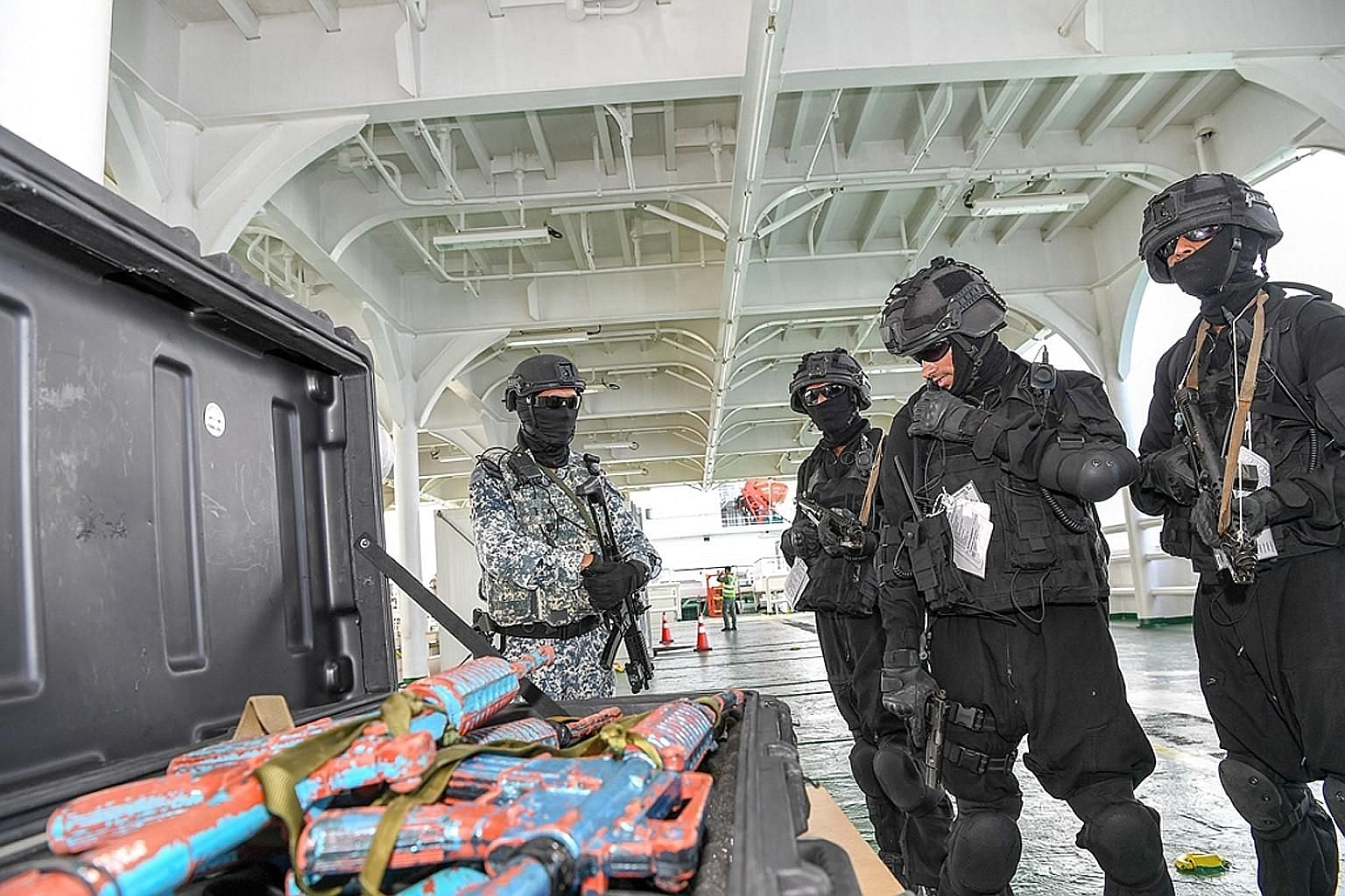 Boarding teams from Brunei, India, South Korea and Singapore simulating a search on a vessel of interest as part of the exercise.
