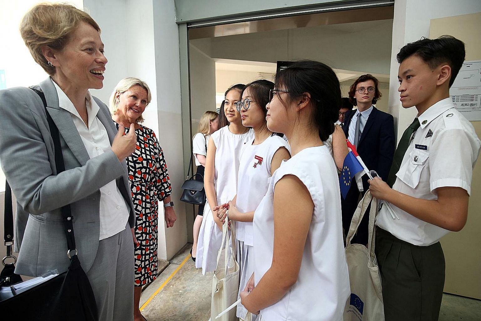 EU Ambassador to Singapore Barbara Plinkert (left) and Finnish Ambassador Paula Parviainen speaking to students after a panel discussion yesterday. European ambassadors will be visiting local schools to give talks on the EU.