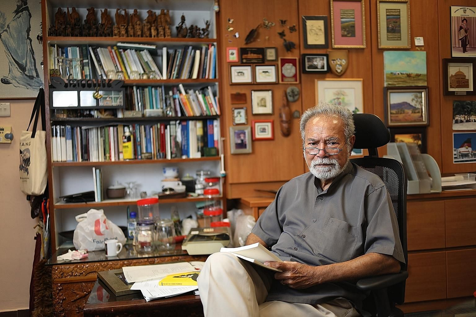 A Gathering Of Themes (above) by Edwin Thumboo (left) gathers 109 poems, from sweeping works on history and nationhood to reflections on religion to love poems about his wife.