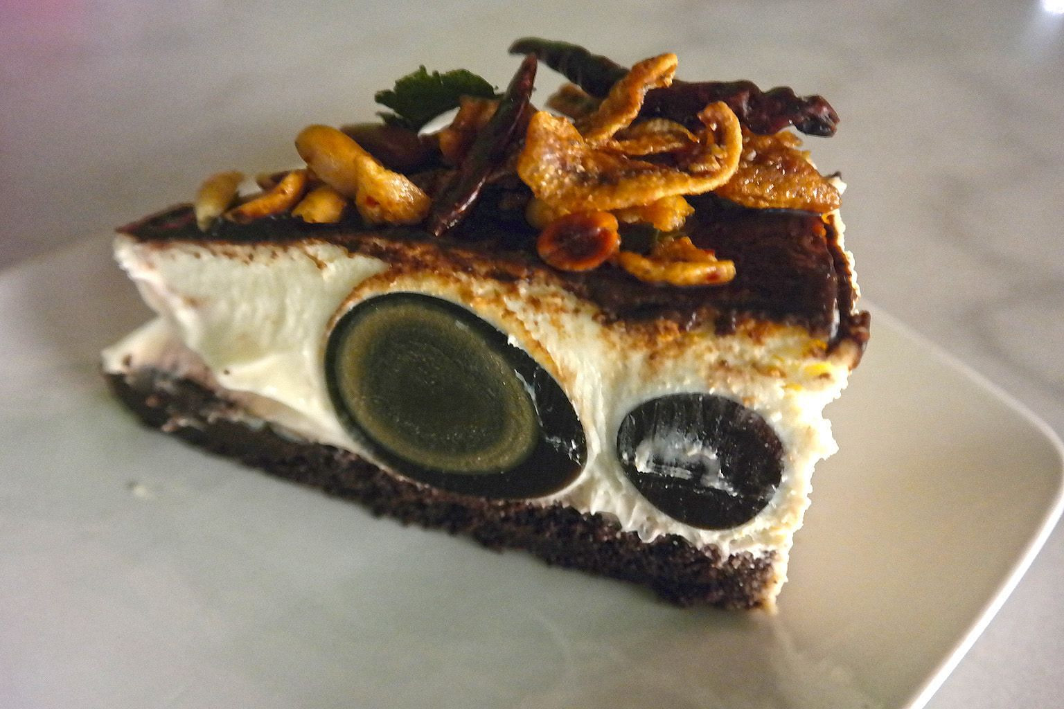 Moody Cow Cafe Penang's Black Moon cheesecake has century egg in the filling and an ikan bilis topping.