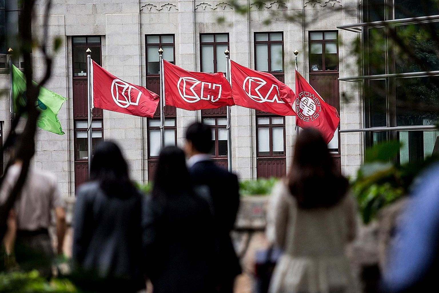 GMT Research says that by deeming a portion of its assets as held for sale, Hong Kong billionaire Li Ka Shing's CK Hutchison Holdings (flags of which are seen above, outside the company's headquarters in Hong Kong) may be hiding HK$57.7 billion (S$10