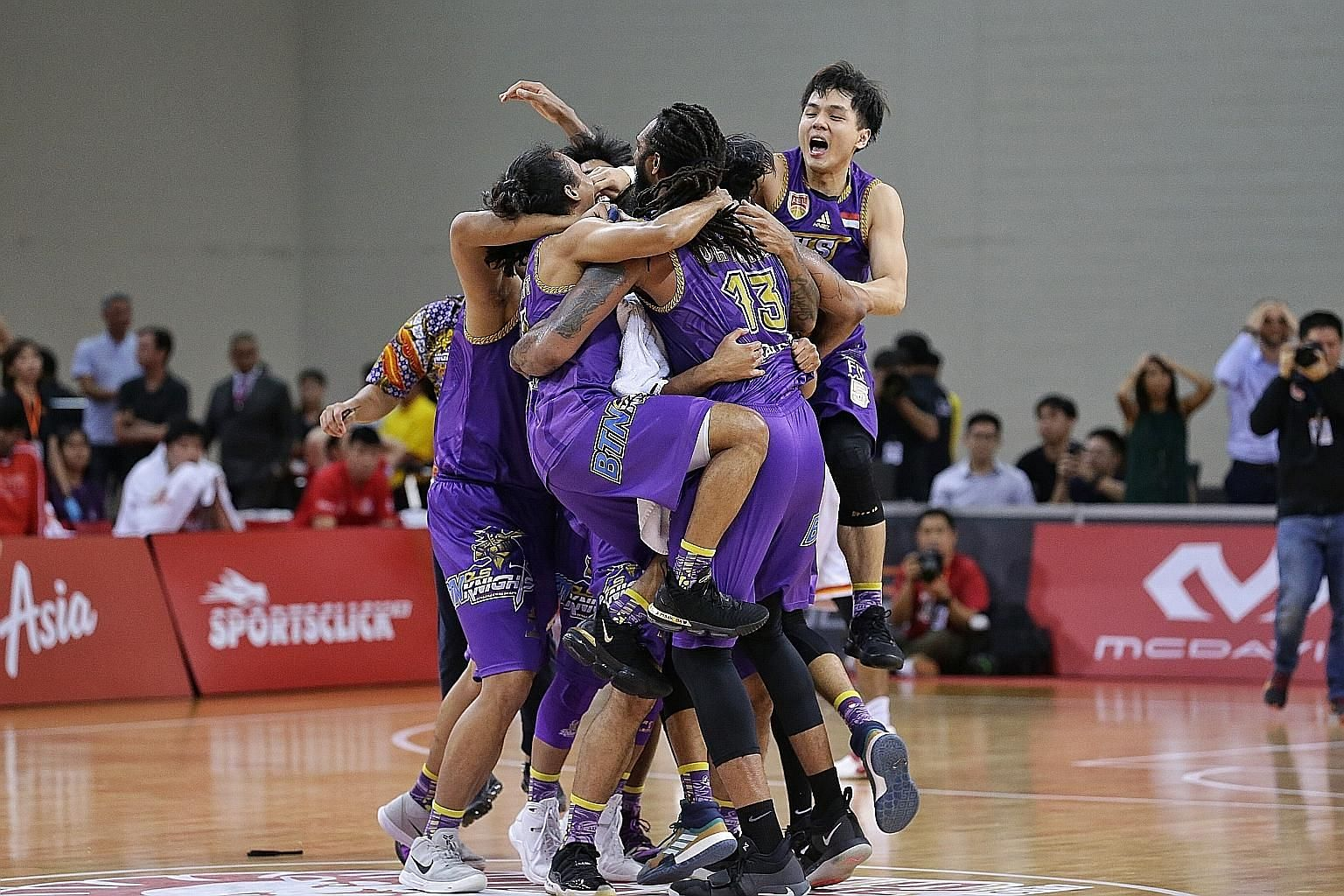 Top: CLS Knights Indonesia celebrate their maiden Asean Basketball League championship win. They beat the Singapore Slingers 84-81 yesterday. ST PHOTO: KEVIN LIM