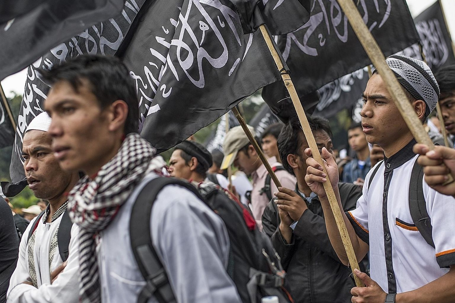 Indonesian Muslims waving the Hizbut Tahrir flag during an anti-government rally in Jakarta in July 2017, to condemn a decree banning groups that oppose Indonesia's official state ideology. The decree was seen as targeting radical Islamists in the co