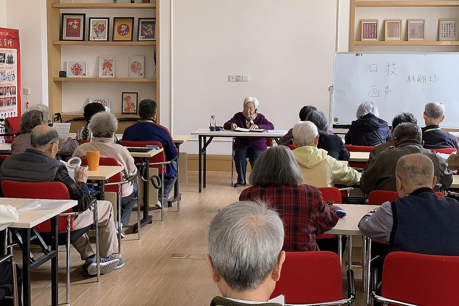 Chinese seniors enjoying lessons on Chinese folk arts at Yan Garden, a high-end retirement home in the northern suburbs of Beijing, which offers a range of activities.