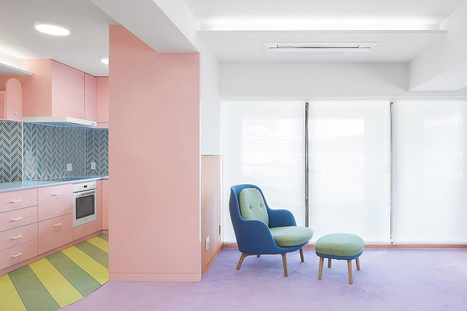 Bold pastels on walls and white ceilings in this Tokyo apartment help create an illusion of height.