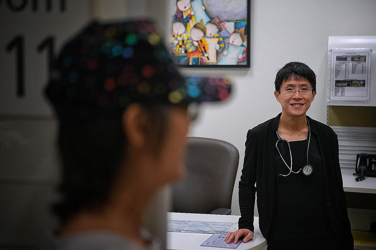 Associate Professor Lee Soo Chin, head of the department of haematology-oncology at National University Cancer Institute, Singapore, with breast-cancer patient Kwok Pui Yee, who started taking the drug last year. Called Olaparib, it kept her cancer u