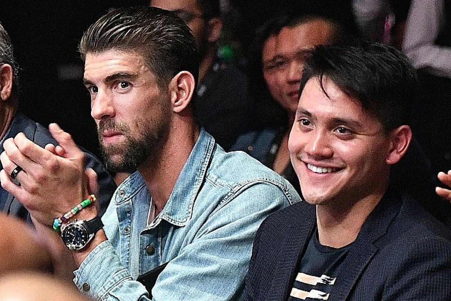 Michael Phelps seated next to Joseph Schooling watching One Championship's Enter the Dragon at the Singapore Indoor Stadium yesterday.