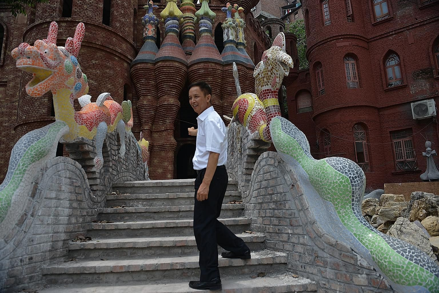"""Chinese millionaire Liu Chonghua at one of his castles outside Chongqing. When sales at his chain of bakeries began to fall, leaving him short of funds, Mr Liu felt a kind of """"formless pressure"""". More entrepreneurs in China feel that President Xi Jin"""