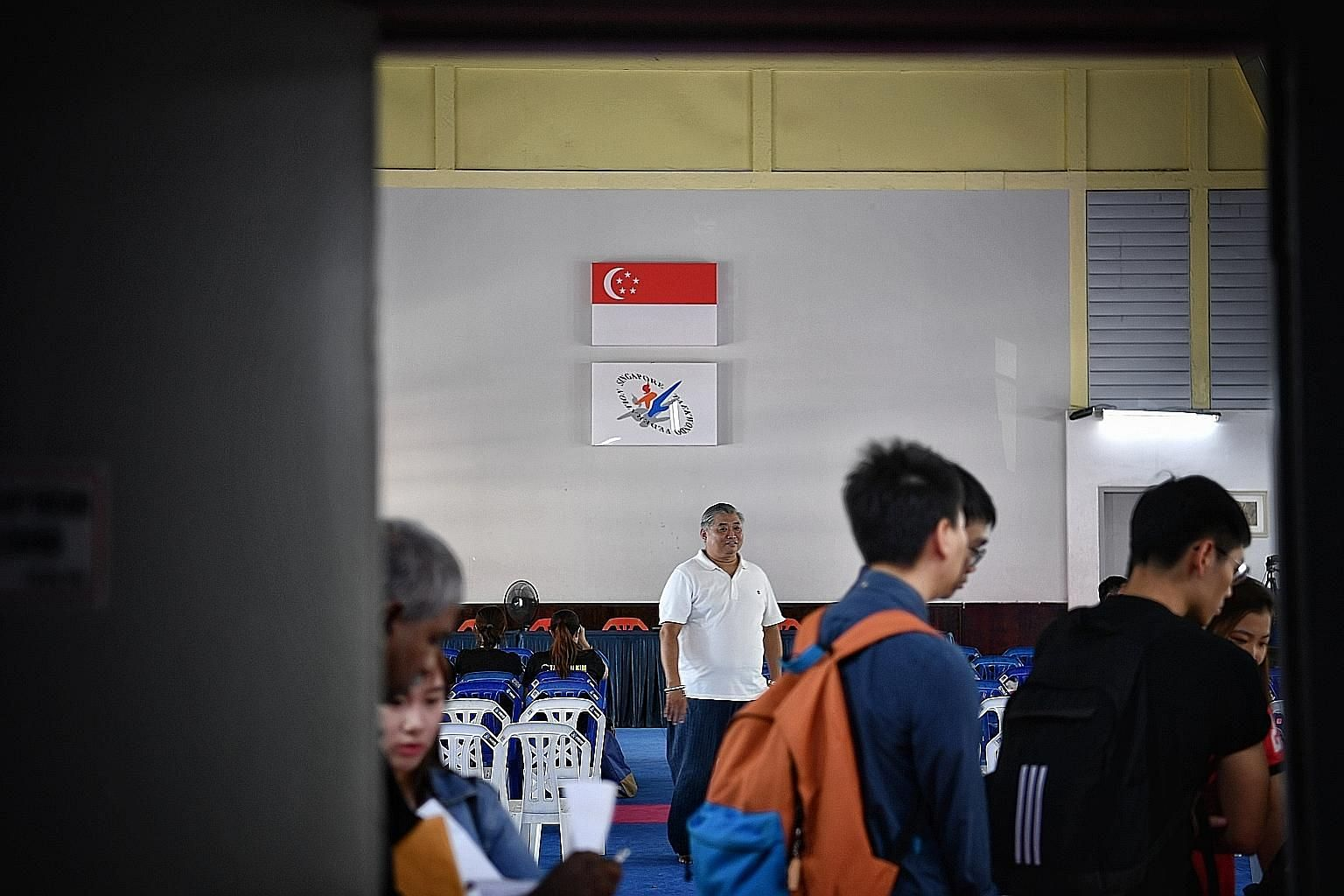 Attendees streaming in for the Singapore Taekwondo Federation extraordinary general meeting yesterday. ST PHOTO: ARIFFIN JAMAR