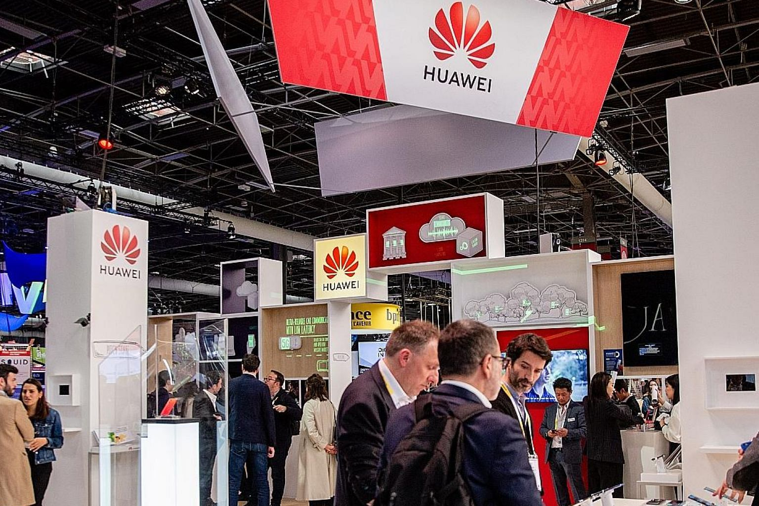 """Left: Huawei Technologies' booth at the Viva Technology conference in Paris last Thursday. Its founder and chief executive Ren Zhengfei (above) said the growth of the Chinese tech giant """"may slow, but only slightly"""" due to the US restrictions."""