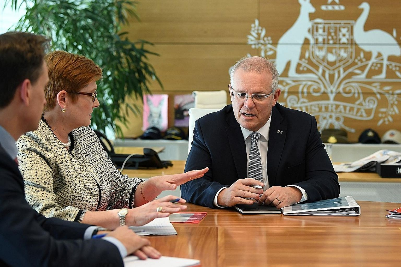 Australia's Prime Minister Scott Morrison with Foreign Minister Marise Payne at a meeting at the Commonwealth Parliament Offices in Sydney yesterday.
