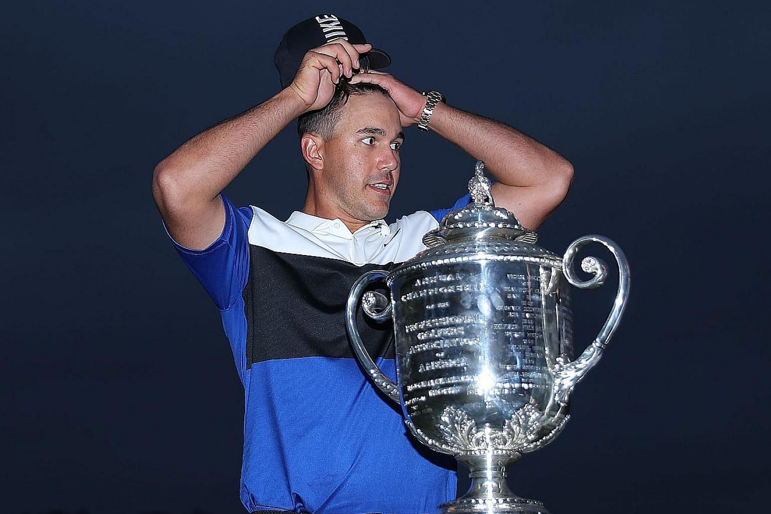 A relieved Brooks Koepka with the Wanamaker Trophy after retaining the PGA Championship at the Bethpage Black Course in Farmingdale, New York on Sunday. Runner-up Dustin Johnson has now finished second at all four Major championships.