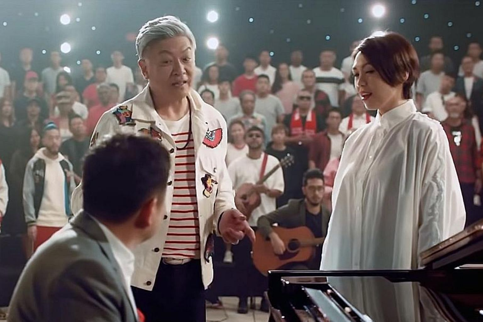 NDP 2019 music director Sydney Tan (in grey, at the piano), with creative director and singer-songwriter Dick Lee, who composed this year's theme song, Our Singapore, and songbird Kit Chan.