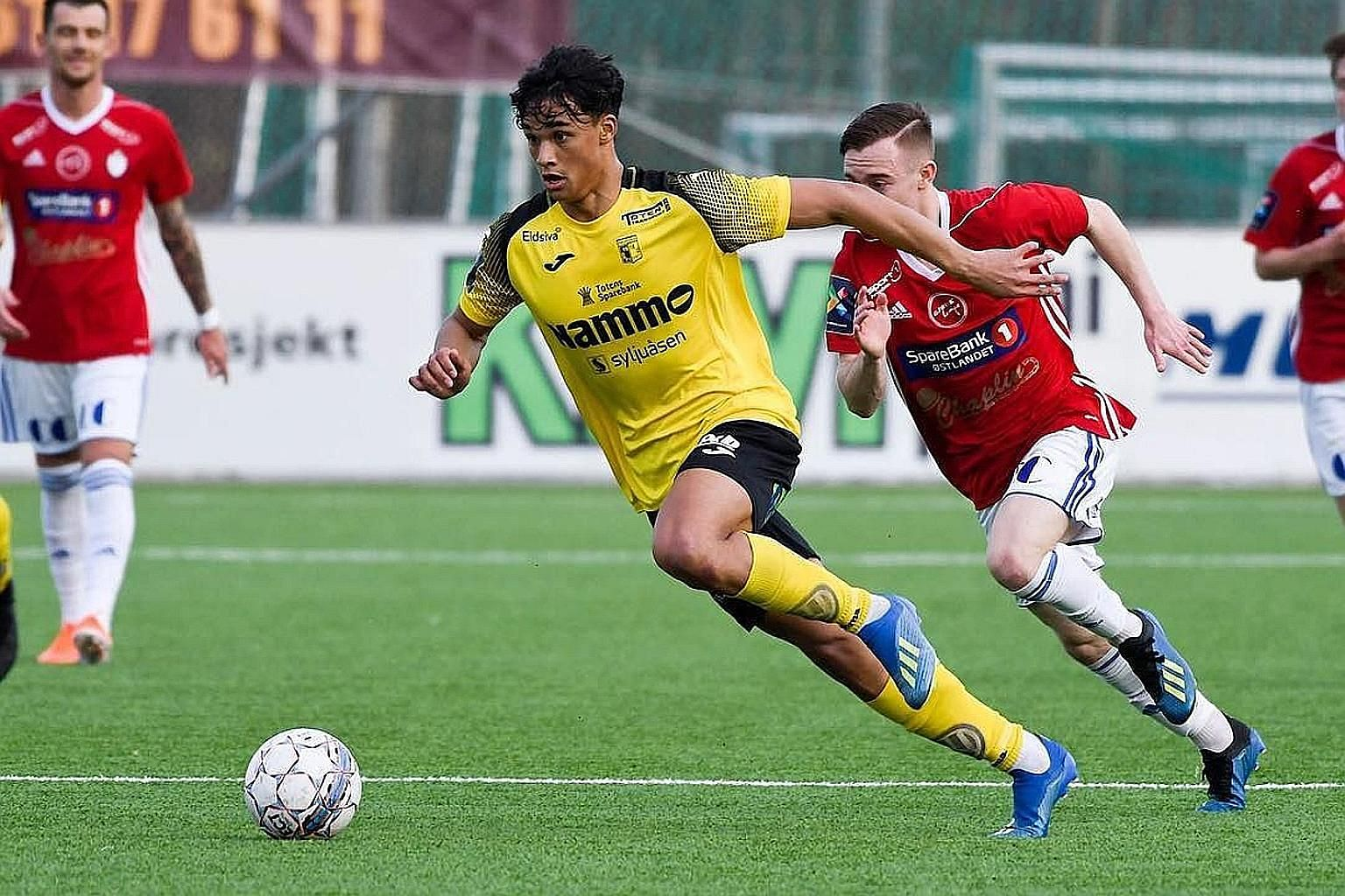 Left: Ikhsan Fandi has scored two goals in seven substitute appearances for Raufoss since his signing in January. Below: Ikhsan helps out although flatmate Parfait Bizoza, a defender, does most of the cooking at home.