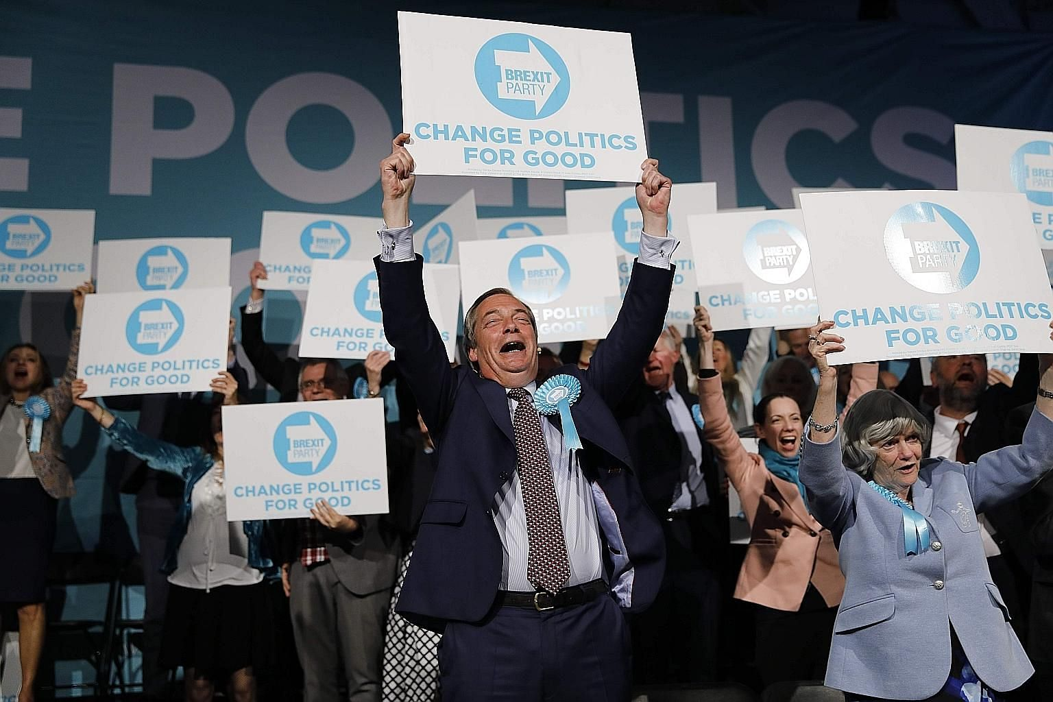 Brexit Party leader Nigel Farage (centre) and his supporters at the end of a European Parliament election campaign rally in Olympia London on Tuesday. Current opinion polls indicate that Mr Farage's party will top the British ballot, and is projected