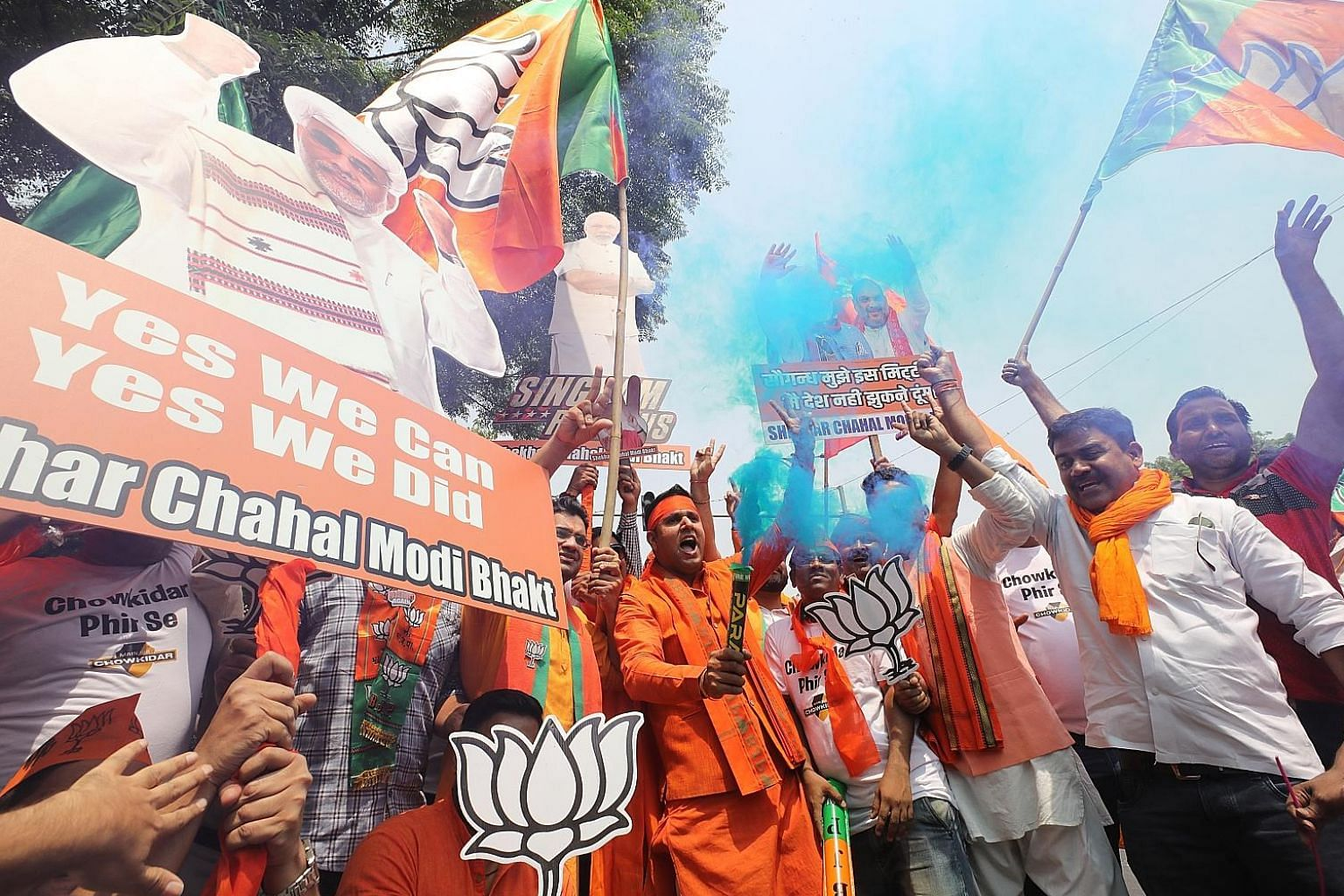 Supporters celebrating Bharatiya Janata Party's (BJP) win in New Delhi yesterday. Not only did the party seem set to improve on its 2014 showing, but it also kept the opposition Congress party down to no more than a marginally better performance than