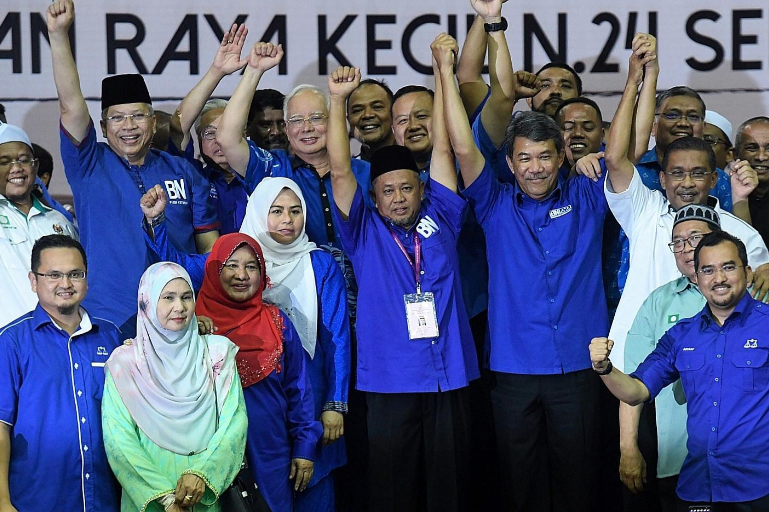 BN candidate Zakaria Hanafi (centre) celebrating his win in a by-election earlier this year with fellow opposition party members including Najib Razak (behind him). PHOTO: BERNAMA