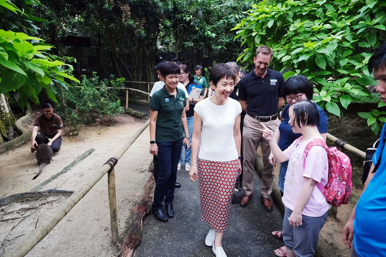 Ms Vivian Wong, 31, a beneficiary of the Movement for the Intellectually Disabled of Singapore, chatting with Minister for Culture, Community and Youth Grace Fu at the Night Safari's wallaby enclosure yesterday. Ms Wong was one of about 50 beneficiar