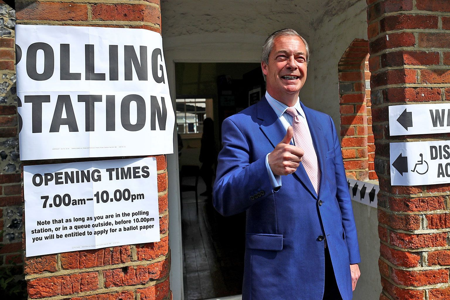 Brexit Party leader Nigel Farage at a polling station in Britain yesterday as the country and the Netherlands kicked off four days of voting in the European Union elections. PHOTO: REUTERS