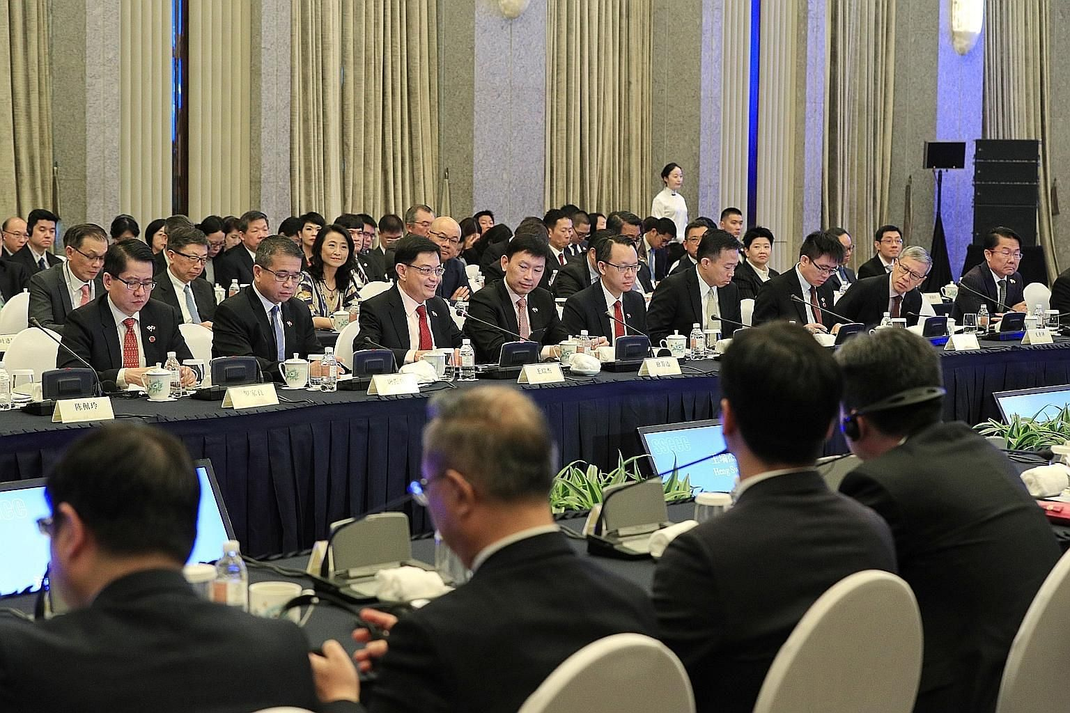 Deputy Prime Minister Heng Swee Keat (third from left) delivering the opening address at the inaugural Singapore-Shanghai Comprehensive Cooperation Council meeting yesterday. The council, which Mr Heng co-chairs with Shanghai Mayor Ying Yong, is Sing