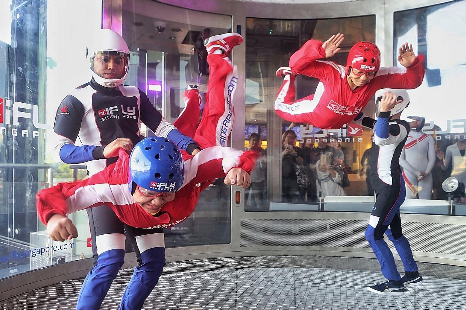 Eleven-year-old Sharandev Jude Joseph (above), a pupil from Awwa School who has autism, was one of 31 students aged between eight and 16 from the school who helped to set a Guinness World Record in indoor tandem skydiving yesterday. They were among t