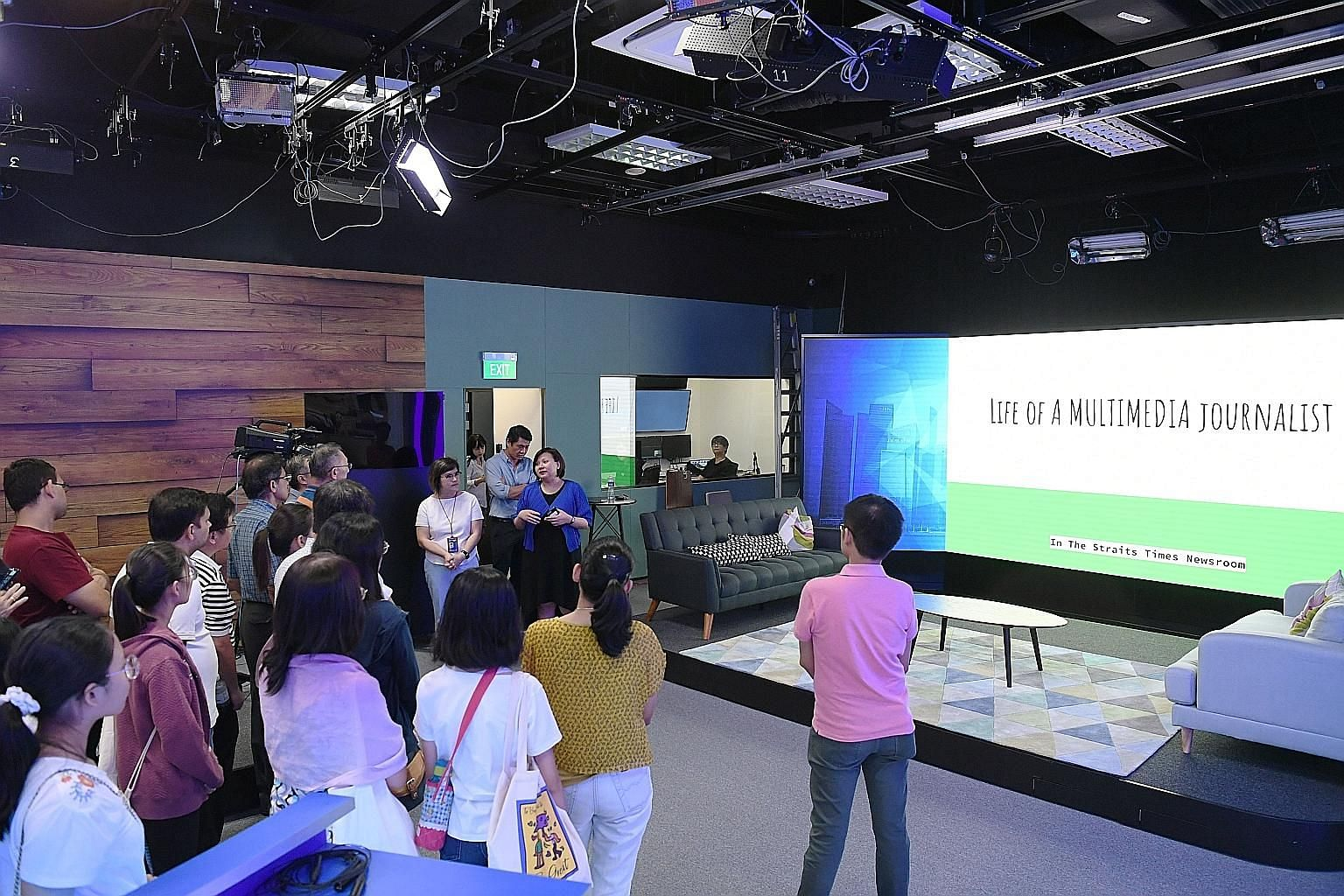 Straits Times subscribers watching a presentation on the life of a journalist by ST digital editor Ong Hwee Hwee (in blue cardigan) in the newsroom's new production studio yesterday.