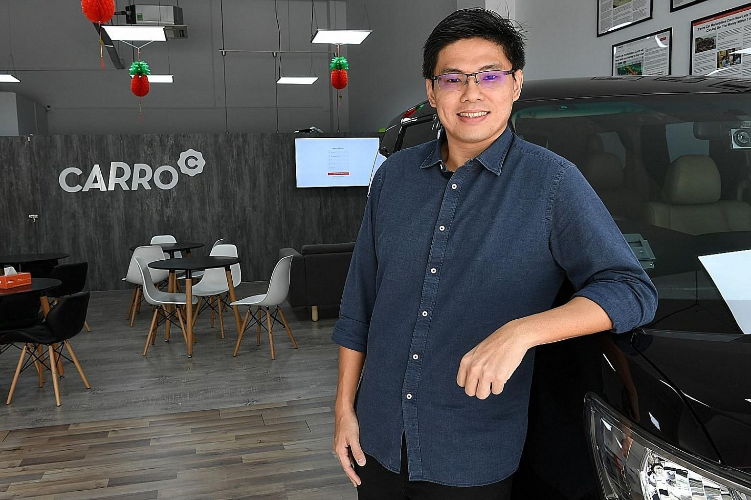 Mr Kelvin Chng, co-founder of Carro, is also involved in an infant clothing distribution and e-commerce business that he started with his wife about seven years ago after they graduated. ST PHOTO: KHALID BABA
