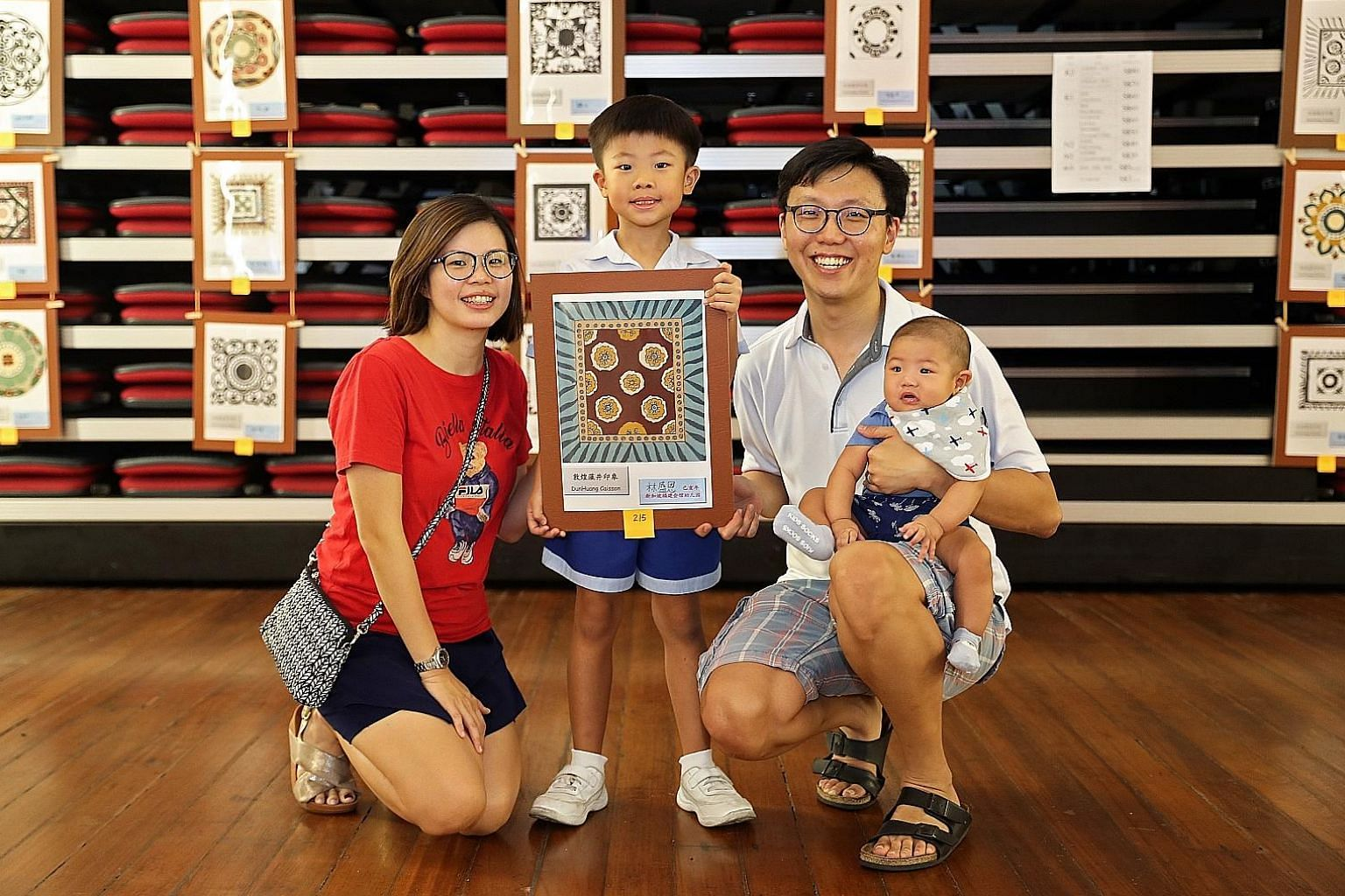 Doing his bit for charity. Davin (centre) with his parents, Jasmine and Tony Lim, and six-month-old brother, Timothy. ST PHOTOS: GIN TAY