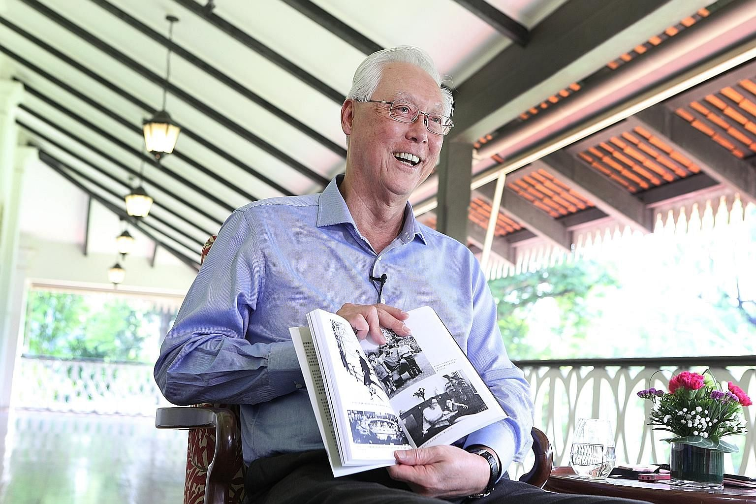 Emeritus Senior Minister Goh Chok Tong with a Chinese-language copy of his biography, Tall Order: The Goh Chok Tong Story, during an interview at the Istana with Lianhe Zaobao that was published in the Chinese daily yesterday. PHOTO: LIANHE ZAOBAO