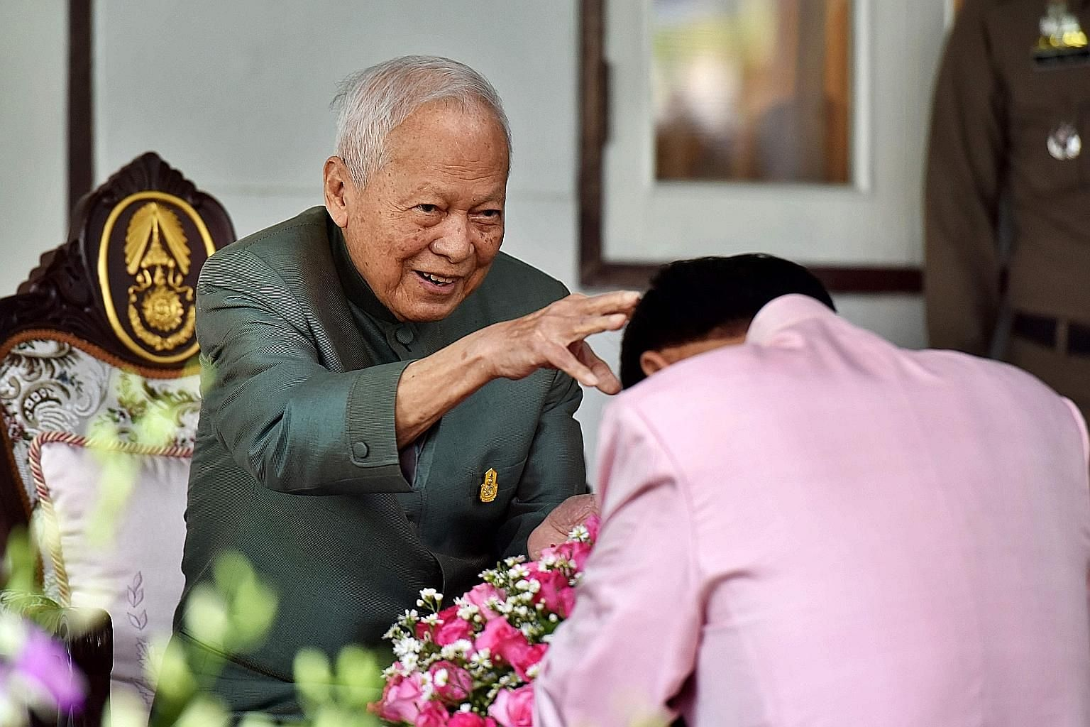 Thailand's former general and prime minister Prem Tinsulanonda receiving PM Prayut Chan-o-cha at a visit during Songkran, the Thai new year, in April last year. Senior army officers would pay their respects to Mr Prem, who was a towering figure in th