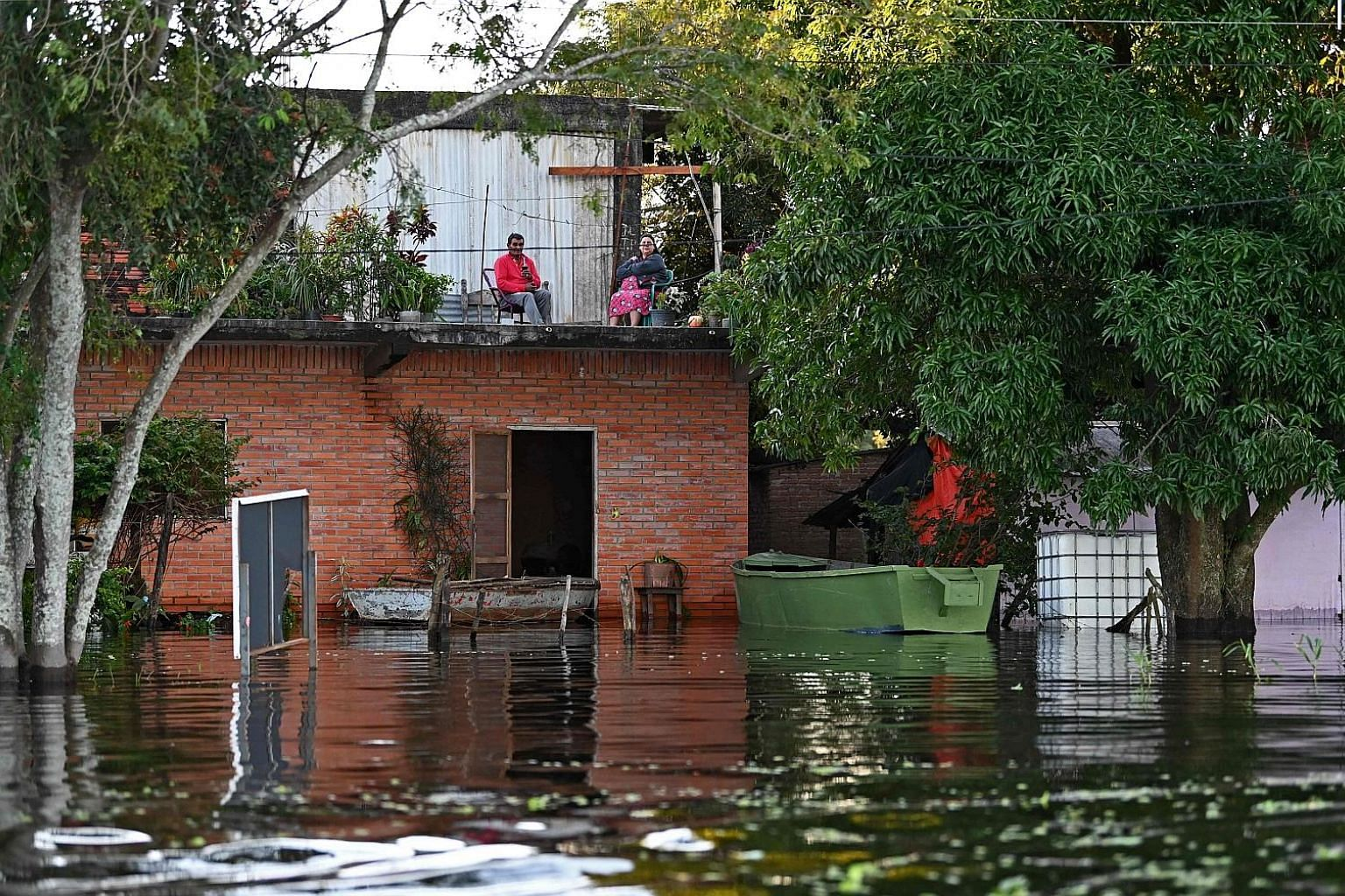 Some residents have opted to remain in their flooded homes in Puerto Falcon, near the capital Asuncion, despite water levels on the Paraguay River rising.