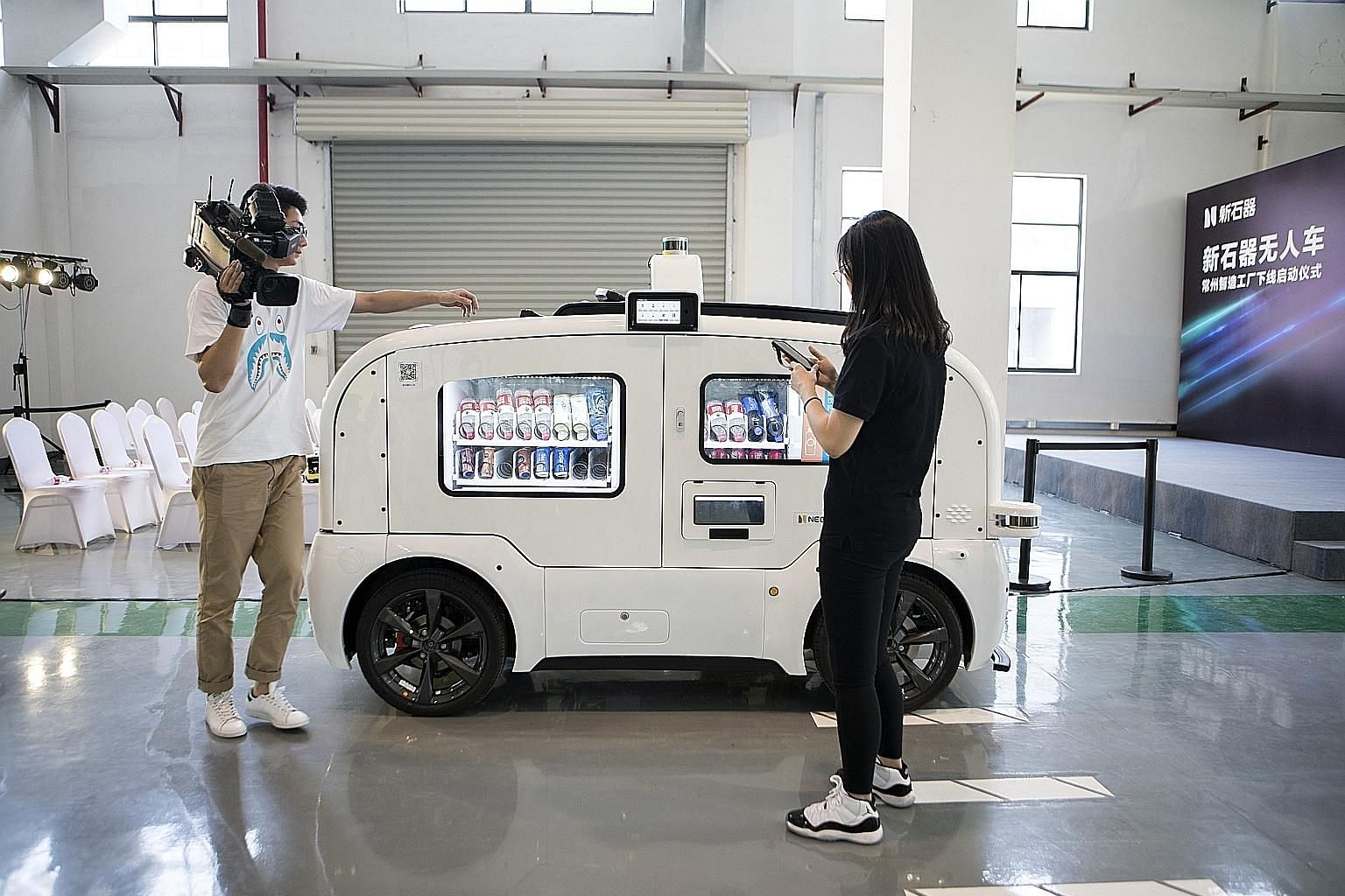 An autonomous vending-machine vehicle at a launch event at Neolix's facility in Changzhou city in China last Friday. The Chinese start-up kicked off mass production of its self-driving delivery vehicles - saying it is the first company globally to do