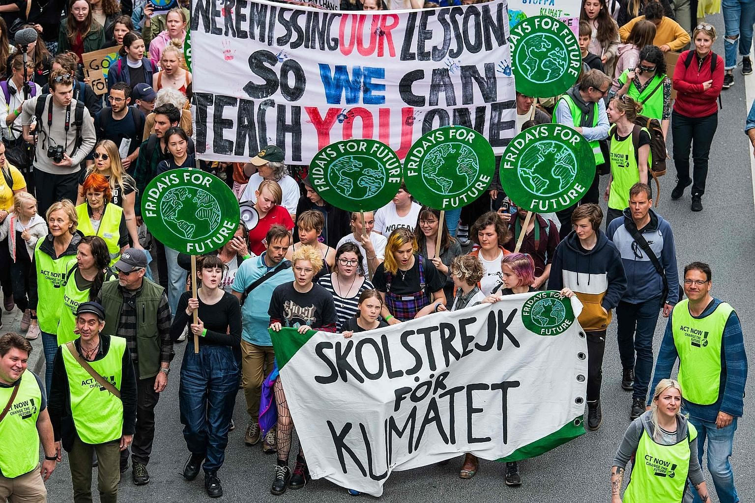 """Sixteen-year-old Swedish climate activist Greta Thunberg (second from left, behind the banner) during the """"Global Strike For Future"""" march in Stockholm last Friday, part of student protests aimed at sparking world leaders into action on climate chang"""