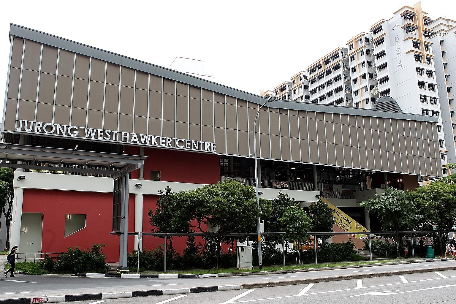 The sign on the facade of Jurong West Hawker Centre will be changed to read Jurong West Hawker Centre and Market to increase awareness of the existence of the wet market, and new signage will also help to direct visitors to the market. ST PHOTO: ZHAN