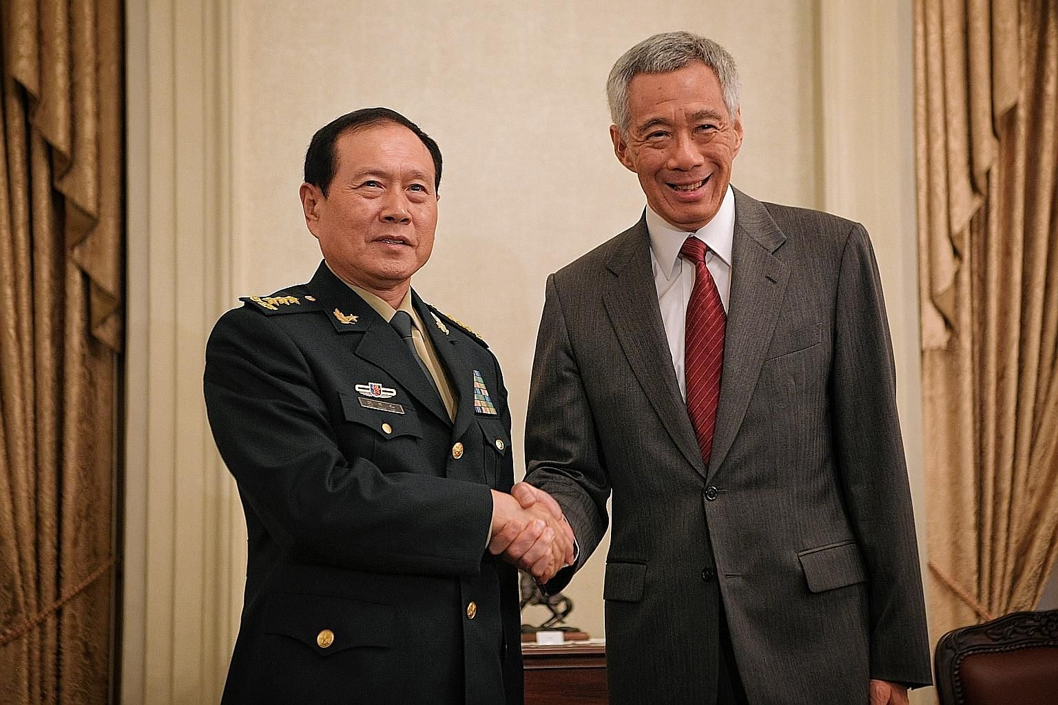 Chinese Defence Minister Wei Fenghe meeting Prime Minister Lee Hsien Loong at the Istana yesterday. They affirmed the longstanding, warm and friendly bilateral relations between Singapore and China, which have progressed steadily over the years, said