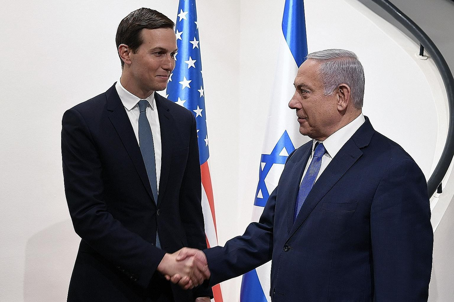 US President Donald Trump's son-in-law and aide Jared Kushner (left) meeting Israeli Prime Minister Benjamin Netanyahu yesterday. PHOTO: EPA-EFE