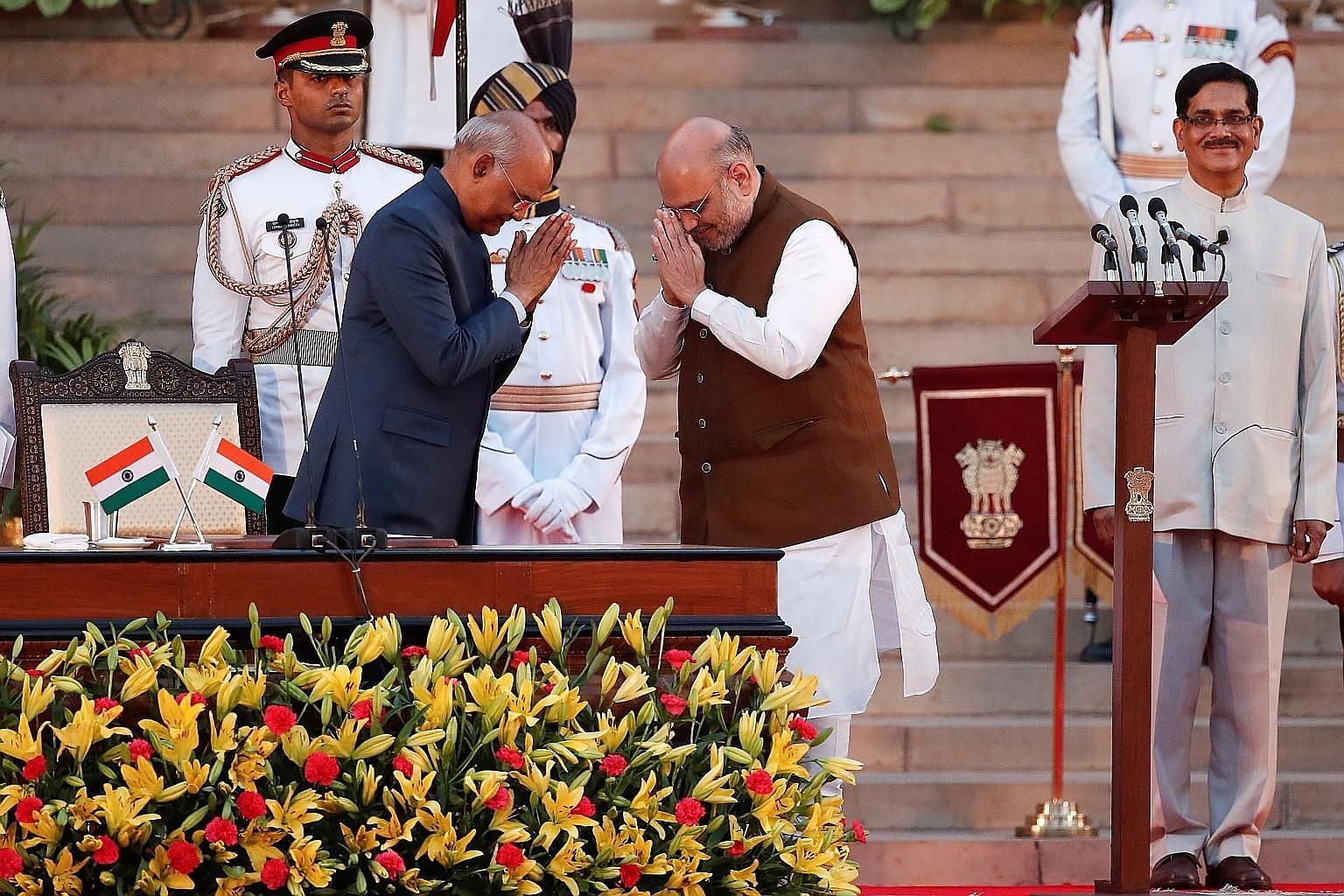 Indian President Ram Nath Kovind (left) greeting new Home Minister Amit Shah after his oath of office during the swearing-in ceremony at the Rashtrapati Bhawan, or presidential mansion, in New Delhi on Thursday. PHOTO: REUTERS