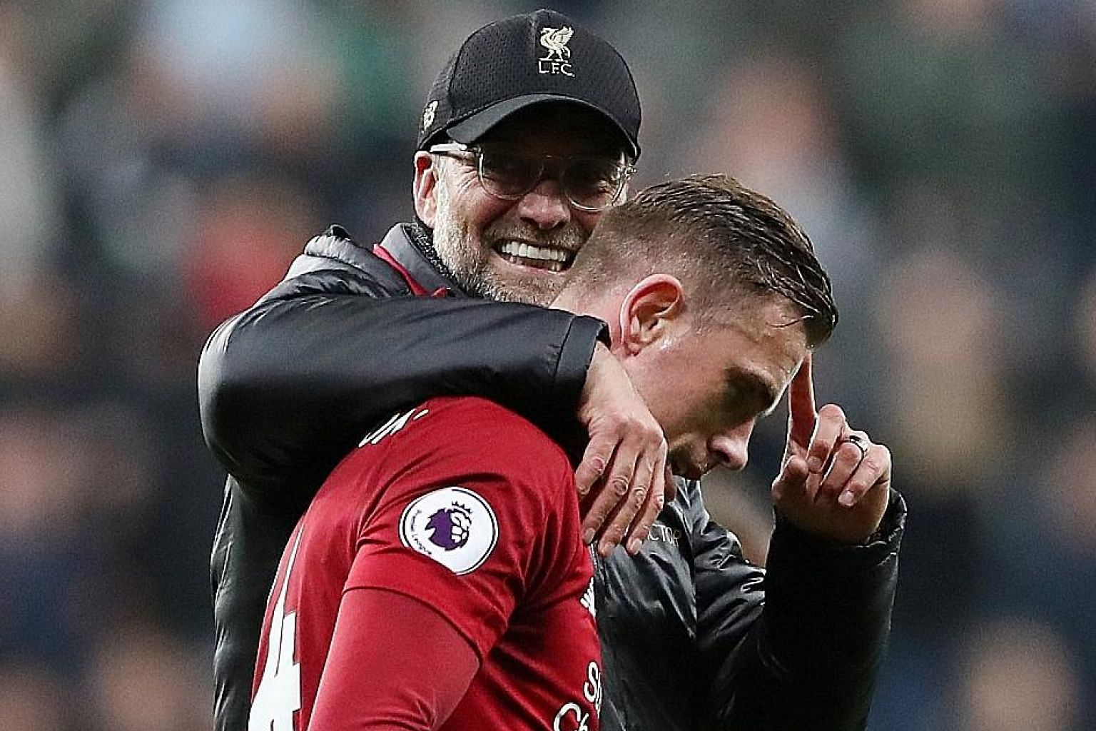 Liverpool manager Jurgen Klopp and Jordan Henderson, his captain and workhorse. The Reds and Tottenham have harnessed English football's traditional strengths, energy and never-say-die spirit, with great success. PHOTO: REUTERS