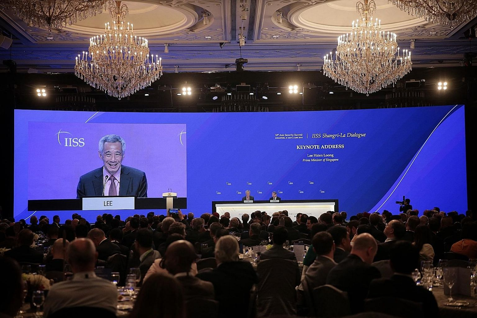 "Prime Minister Lee Hsien Loong at a question and answer session after delivering the keynote address at the Shangri-La Dialogue last night. PM Lee said it is natural that the United States and China will ""vie for power and influence, but competition"