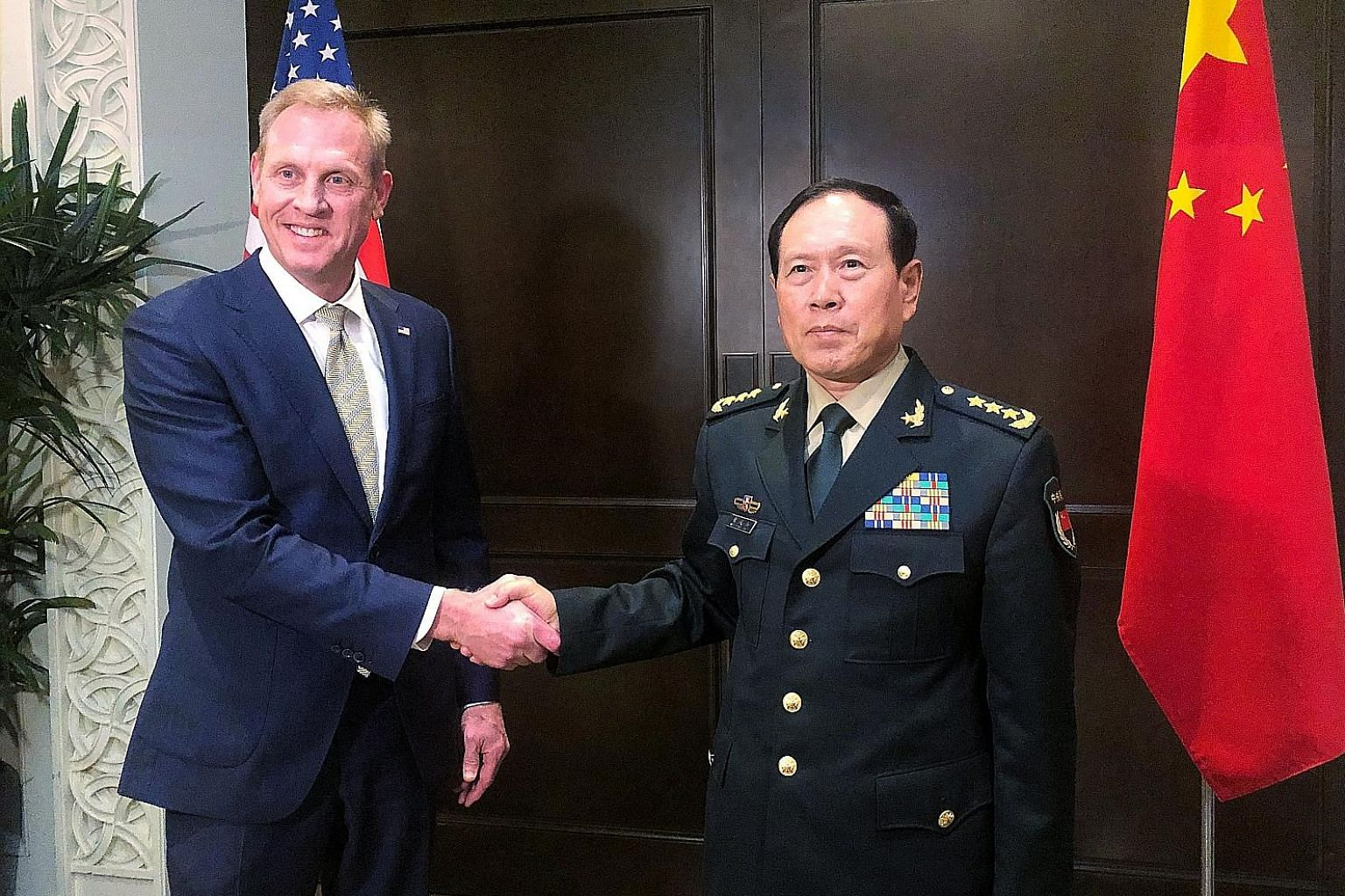 US Acting Defence Secretary Patrick Shanahan and Chinese Defence Minister Wei Fenghe meeting on the sidelines of the Shangri-La Dialogue yesterday.