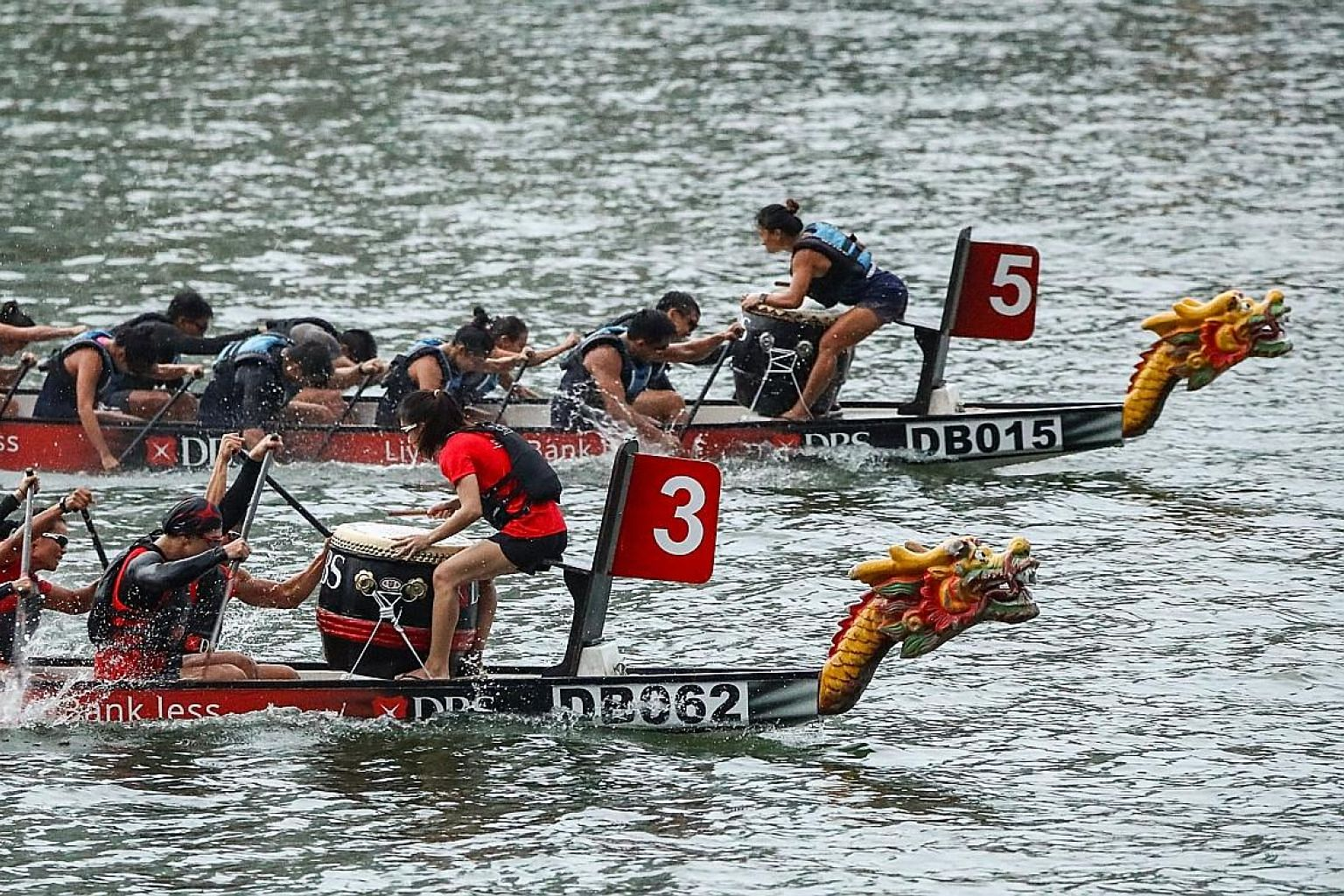 KPMG Dragonboat A (No. 5) pipped defending champions DBS Bank Ltd A (No. 3) to the 200m corporate mixed title at The Promontory @ Marina Bay yesterday.