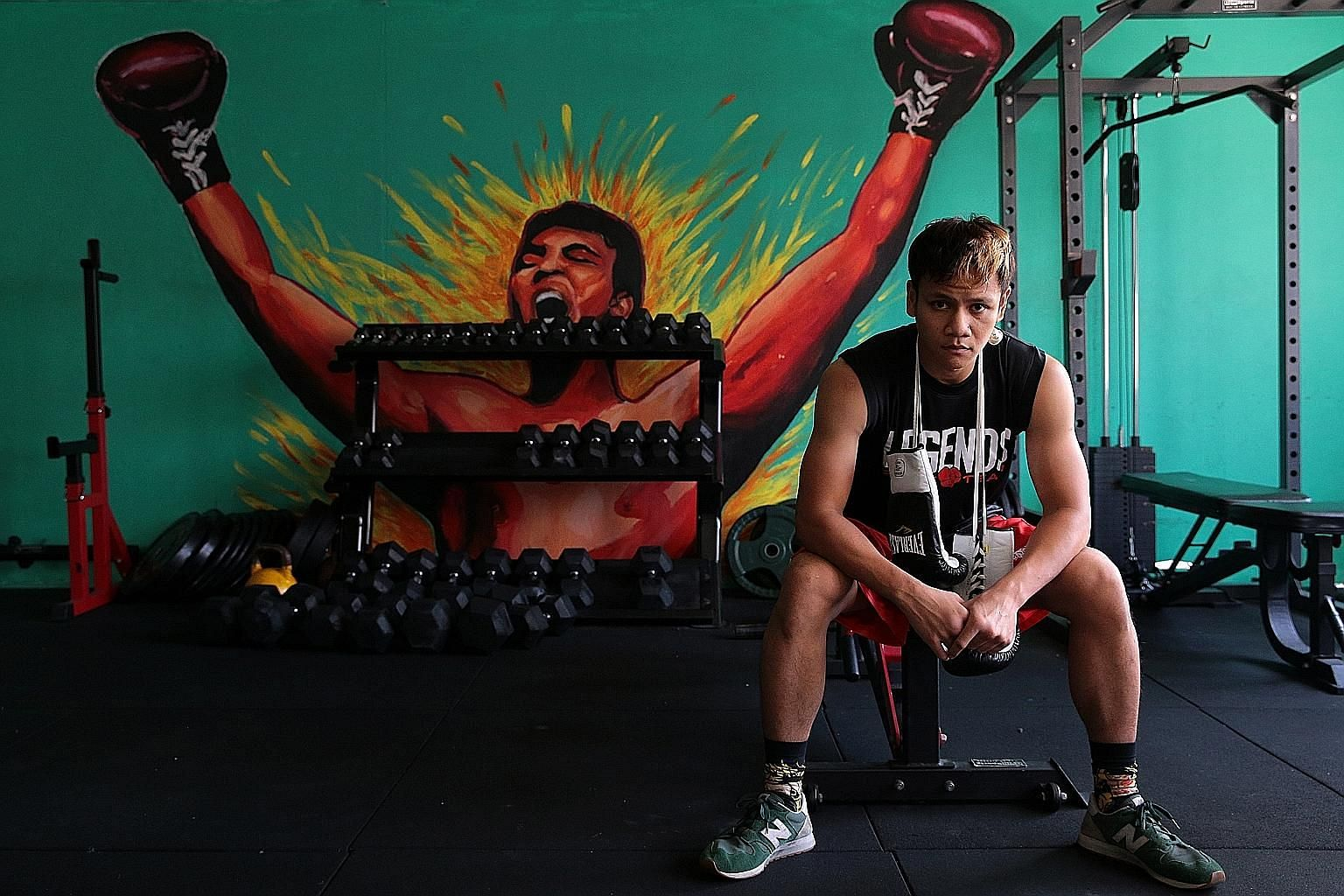 Singapore pro boxer Muhamad Ridhwan's career has been left in limbo after Scott O'Farrell, CEO and face of his management company, Ringstar Asia, resigned in April. Muhamad Ridhwan on the ropes against Namibia's Paulus Ambunda in their IBO super bant