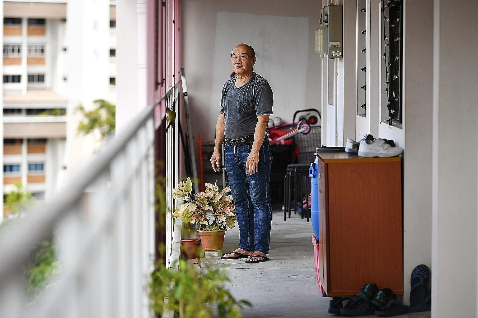 Mr Chow Yit Keong, 66, outside his one-room rental flat. The retired odd-job worker gets by on about $500 a month. A study out last month suggests that he may need more money if he wants to be able to thrive in his golden years, rather than just surv