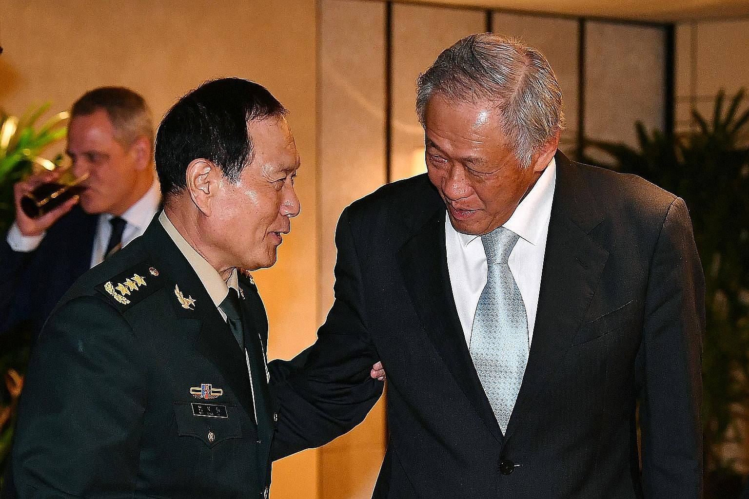 China's Defence Minister Wei Fenghe with Defence Minister Ng Eng Hen during the second ministerial roundtable hosted by Dr Ng at the Shangri-La Dialogue yesterday. ST PHOTO: LIM YAOHUI