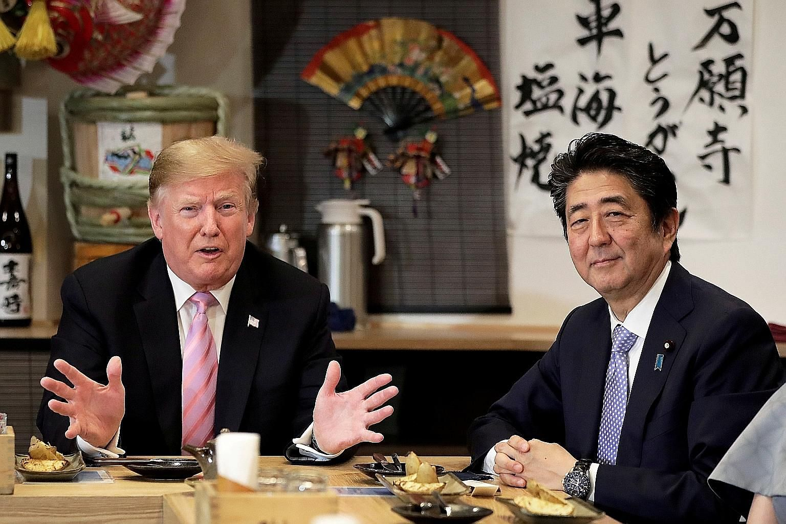 US President Donald Trump and Japanese Prime Minister Shinzo Abe (right) during dinner in Tokyo last month. Mr Trump is among several world leaders Mr Abe will be hosting at the G-20 Summit in Osaka on June 28-29.