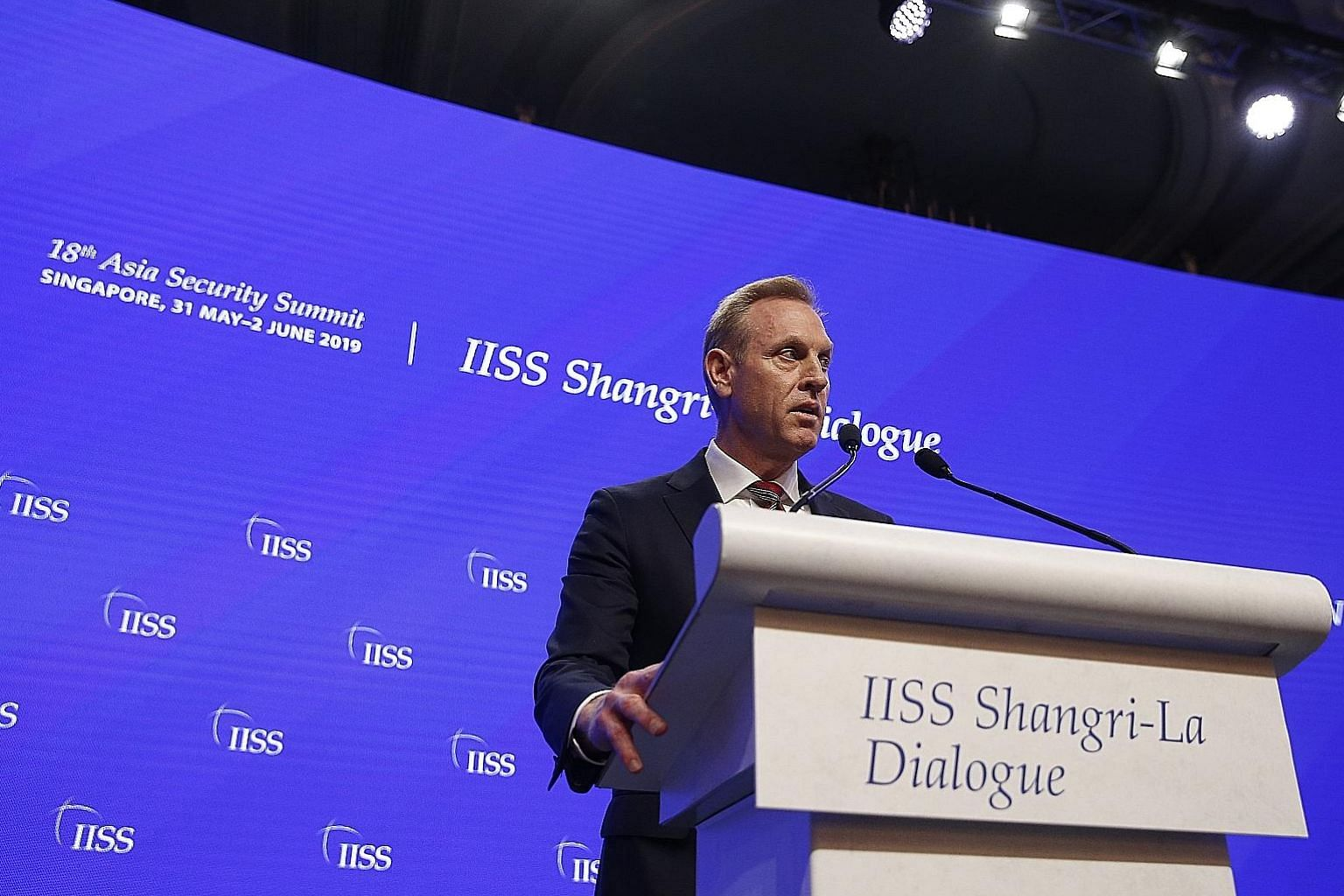 Acting US Defence Secretary Patrick Shanahan speaking at the Shangri-La Dialogue on Saturday, in his first major speech in Asia. Without mentioning China by name, he said it posed the greatest long-term threat to the region. PHOTO: EPA-EFE