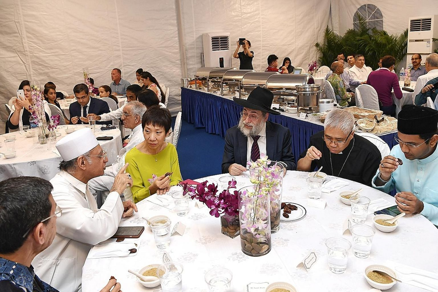 Present at the break-fast session are (from left) Muis president Mohammad Alami Musa, Imam Habib Hassan Al-Attas, Minister for Culture, Community and Youth Grace Fu, Chief Rabbi of Singapore Mordechai Abergel, Archbishop William Goh Seng Chye and Nom