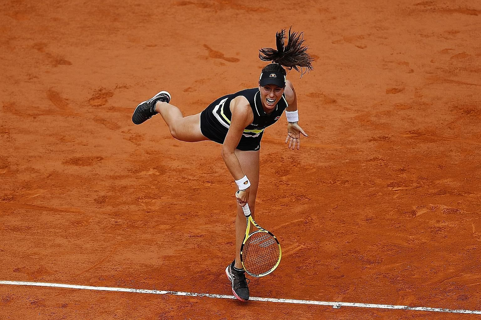 Johanna Konta serving to American Sloane Stephens in their French Open quarter-final yesterday. She won 6-1, 6-4 to become the first British semi-finalist since 1983.