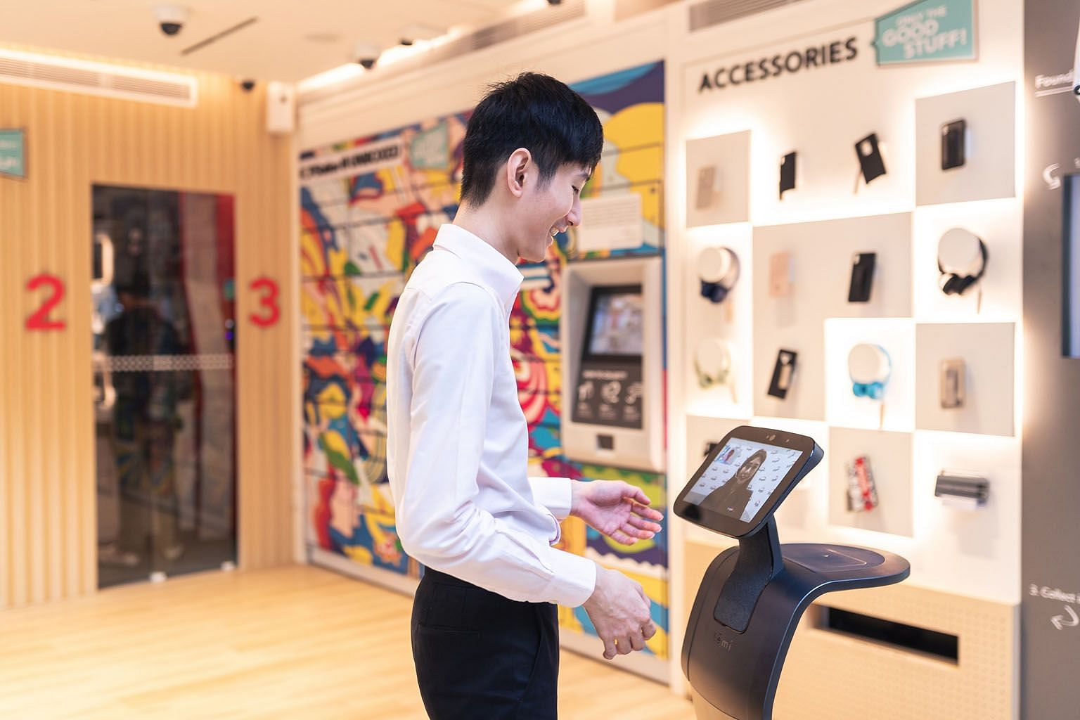 Singtel's first unmanned pop-up store at 20 Pickering Street has no shop assistants, but customers are greeted by a service staff member via a video screen on a roving robot. It is a self-service store that allows customers to try out phones, sign up
