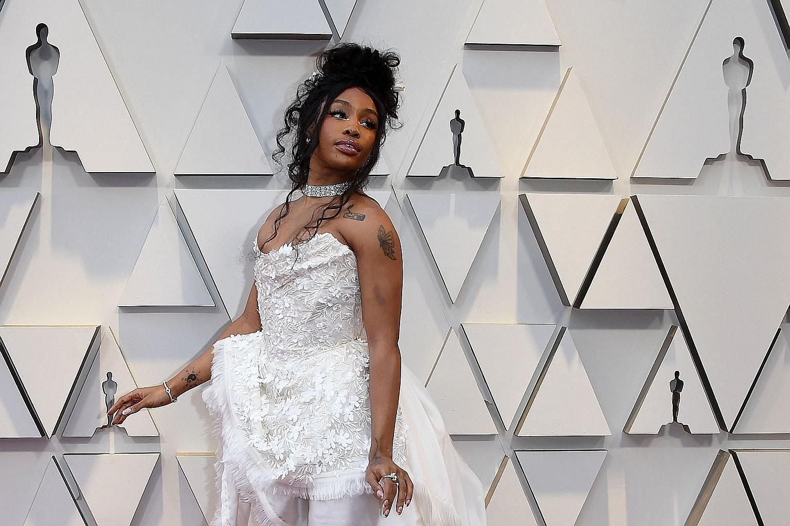 """Sephora has apologised to R&B star SZA (above) after she said a store employee in California """"called security to make sure I wasn't stealing""""."""